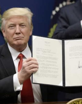 Trump holding signed immigration policy