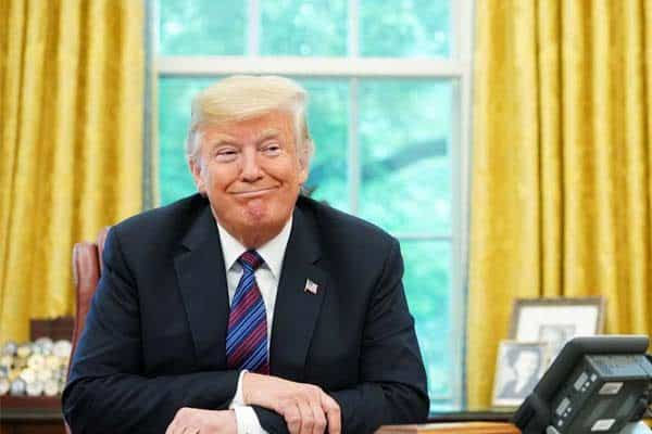Trump ponders at desk