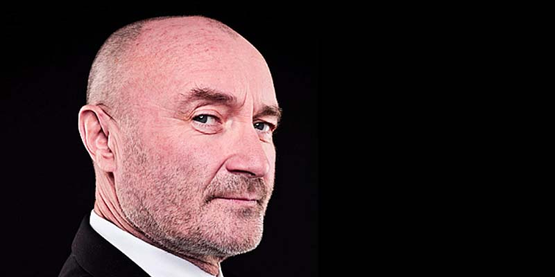 Phil Collins in profile looking smugly at the camera
