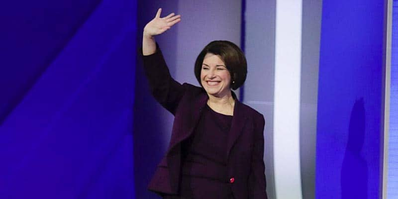 Amy Klobuchar waving goodbye