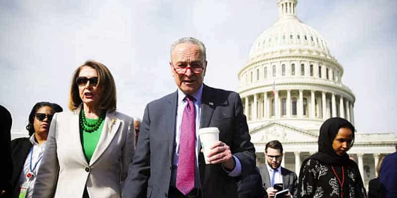 Chuck Shumer Nancy Pelosi and other Democrats walking in front of the US Capitol