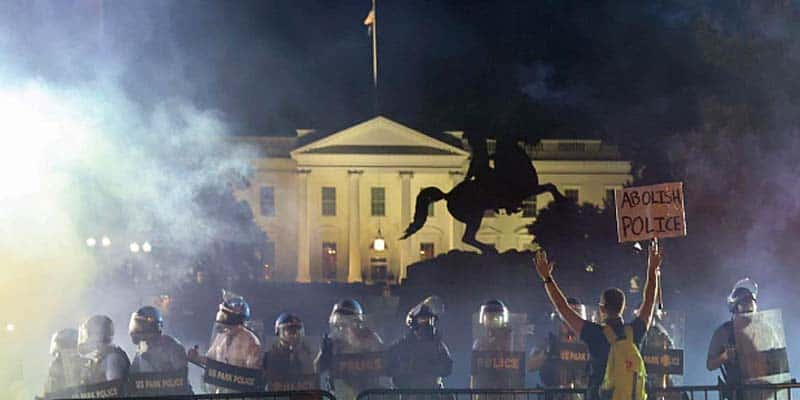 protests occurring in front of the White House at night