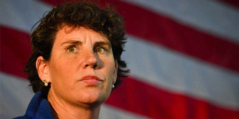 Amy McGrath in front of an American flag