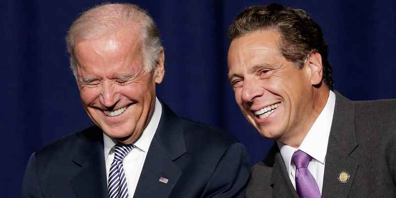Biden standing to the left of Andrew Cuomo