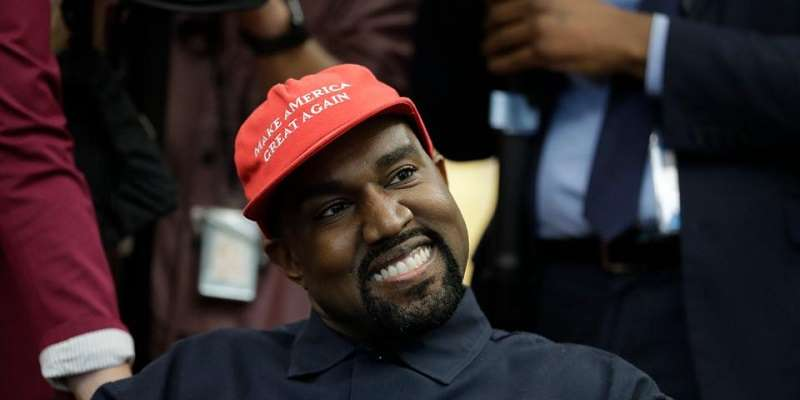 Kanye West wearing a Make America Great Again hat