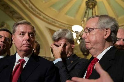 Lindsey Graham standing to the left of Mitch McConnell facing the press