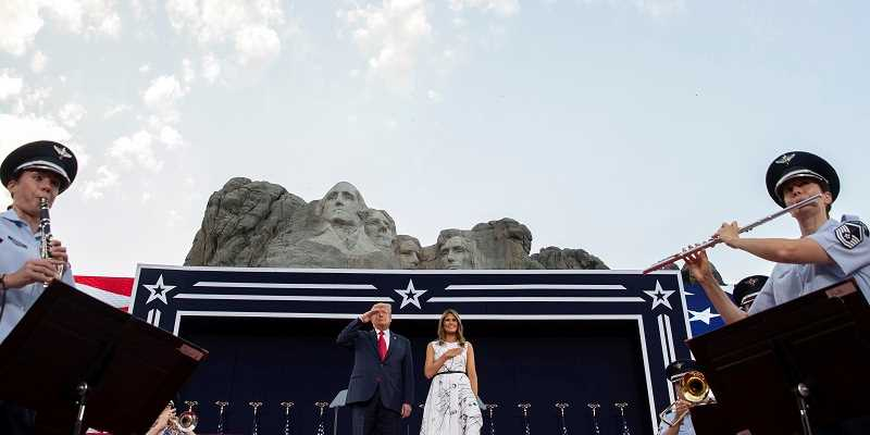 Donald and Melania Trump at a podium in front of Mt. Rushmore