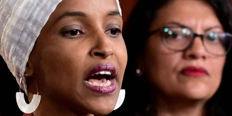 Ilhan Oman to the left of Rashida Tlaib