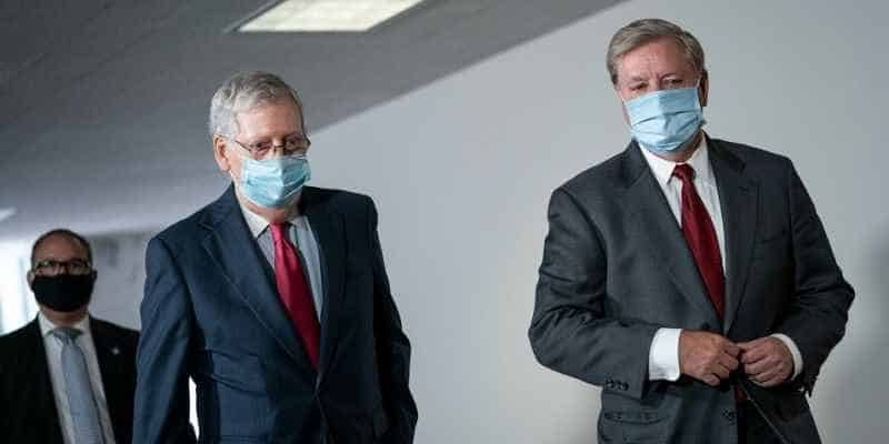 Mitch McConnell and Lindsay Graham walking together with masks on