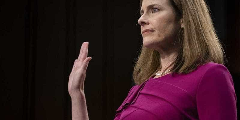 amy coney barrett giving her oath before supreme court hearings